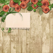 Old wooden background with paper roses and a place for text — Stock Photo