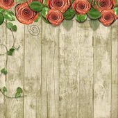 Old wooden background with paper roses and with space for text — Stock Photo