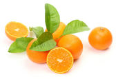 Ripe juicy tangerines and green leaf — Stock Photo
