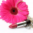 Pink flower and lipstick — Stock Photo #13156042