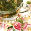 Cup with tea and roses — Stock Photo