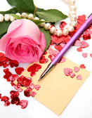 Pink rose and the handle — Stock Photo