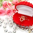 Stock Photo: Pink roses and gold ring