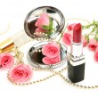 Pink roses and lipstick — Stockfoto