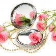 Pink roses and mirror — Stock Photo