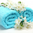 Towel and flowers — Stock Photo