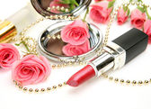 Pink roses and lipstick — Stock Photo