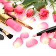 Decorative cosmetics and pink roses — Stock fotografie