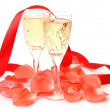 Wine and petals of roses — Stock Photo
