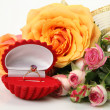 Roses and a gold ring — Stock Photo