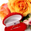 Stock Photo: Roses and a gold ring