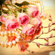 Stock Photo: Pink roses and pearls