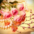 Pink roses and pearls - Stockfoto