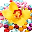 Brilliant ornaments and yellow orchid — Stock Photo #14383409