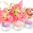 Pink lilies and candles — Stock Photo #14383759