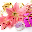 Box with a gift and lilies — Stock Photo #14384037