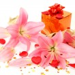 Box with a gift and lilies — Stock Photo #14384509