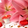 Pink lilies and candles — Foto Stock