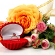 Stock Photo: Gold ring and roses