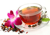 Tea and pink orchid — Stock Photo