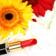 Decorative cosmetics and flowers — Stock Photo