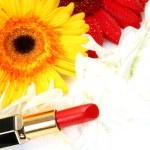 Decorative cosmetics and flowers — Stock Photo