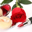 Scarlet rose and lipstick — Stock Photo