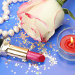 Stock Photo: Decorative cosmetics and rose