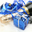 Champagne and christmas ornaments — Stock Photo