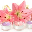 Pink lilies and candles — Stock Photo #17850631