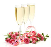 Champagne and pink roses — Stock Photo