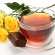 Tea and yellow roses — Stock Photo