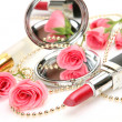Decorative cosmetics and roses — Stock Photo
