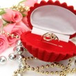Gold ring and roses — Stock Photo #18958935