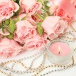 Fine roses and candle — Stock Photo