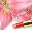 Lipstick and pink lilies — Stock Photo