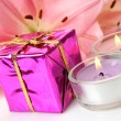 Pink lilies and gifts — Stock Photo