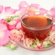 Tea and petals of pink roses — Lizenzfreies Foto