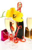 Champagne and yellow tulips — Stock Photo