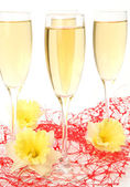Champagne and yellow flower — Stock Photo