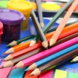 Color pencils and paints — Stock Photo #24236359