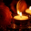 Rose and burning candle — Stock Photo #24236869