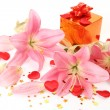 Stock Photo: Boxes with gifts and pink lilies