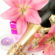 Stock Photo: Champagne and pink lilies