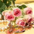 Fine roses and pearls — Stock Photo #24237603