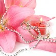 Pink lilies and candles — Stock Photo
