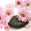Pink flowers and candles - Stock Photo
