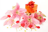 Boxes with gifts and pink lilies — Stock Photo