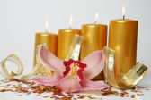 Orchids and candles — Stock Photo