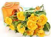 Gifts and bouquet of roses — Stock Photo